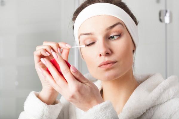 Woman removing eyes make-up